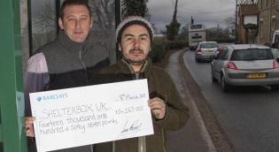 Greg Davis and Juan Romero with a £14,167 cheque for ShelterBox