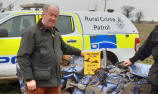 PCC Tim Passmore (left) with a crushed car - pic Suffolk Constabulary